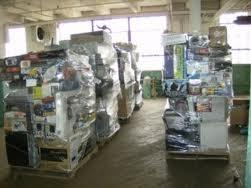 Pallets of product stretch-wrapped in a warehouse