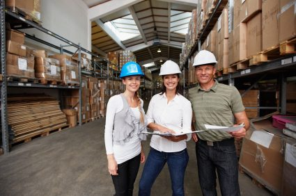 man and 2 women take physical inventory of a warehouse