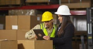 Female warehouse worker using a tablet PC in the Warehouse