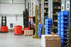 Warehouse using orderpickers to store and retrieve cases in shelving